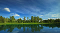 Summer lake landscape with clouds running across the sky, time-lapse. HD Footage