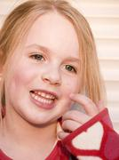Stock Photo of Germany, Bavaria, Close up of girl looking away, smiling