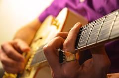 Jazz Guitar Player With Ring - stock photo
