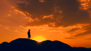 Stock Video Footage of Man Hikes Views Sunset