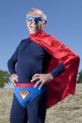 Austria, Burgenland, Senior man in superman's costume Stock Photos