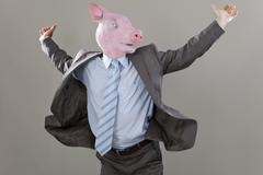 Close up of businessman with pigs head enjoying in office against grey Stock Photos