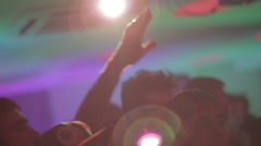 Light flare shining through clapping waving hands in night club, click for HD Stock Footage