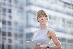 Stock Photo of Germany, Bavaria, Munich, Young businesswoman with digital tablet