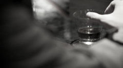 Man Stroking Shot Glass Stock Footage