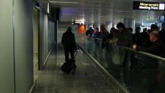People with bags coming out of airport arrival to meeting point, click for HD Stock Footage