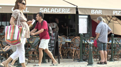 Bar grill with passers-by, France Stock Footage