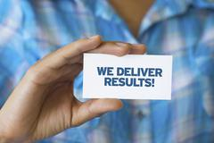 we deliver results - stock photo