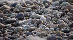 Beach rocks with water ripple Stock Footage
