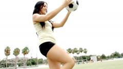 Sexy soccer woman with ball on knee slow motion Stock Footage