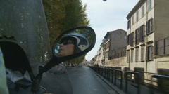 Lady on a scooter in Rome - 2 - slomo Stock Footage