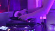 Stock Video Footage of rhythmic moving female DJ changes the CD disk at the deck, click for HD