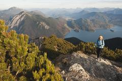 Germany, Bavaria, Senior woman at heimgarten and herzogstand mountain ranges - stock photo