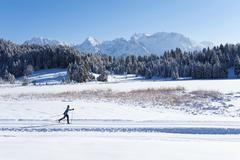 Stock Photo of Germany, Bavaria, Isar Valley, Senior woman doing cross country skiing