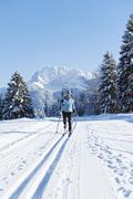 Germany, Bavaria, Isar Valley, Senior woman doing cross country skiing Stock Photos