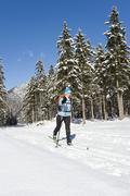 Austria, Arlberg, Man skiing downhill - stock photo