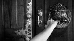Medieval Door Knock knock BW - stock footage