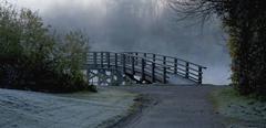 Germany, Bavaria, Amper, View of bridge in mist - stock photo