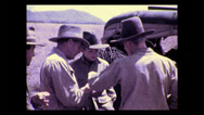 Stock Video Footage of Sharing lunch along the road, Tanzania 1937