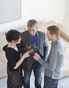 Stock Photo of Germany, Munich, Men and woman drinking wine