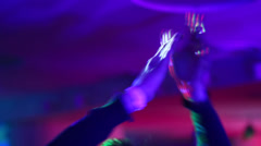 Clapping hands with club bracelet on dance floor in night club, click for HD Stock Footage