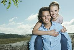 Stock Photo of Italy, Tuscany, Young woman embracing man