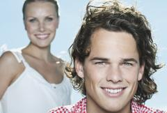 Stock Photo of Italy, Tuscany, Close up of young woman and man, portrait, smiling