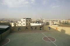 Amman, Jordan, View of playground with city in background - stock photo