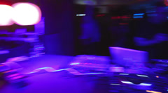 DJ, camera turns round to people dancing in night club at party, click for HD Stock Footage