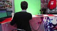 Stock Video Footage of Man comment football soccer match. TV stadium studio greenscreen, click for HD