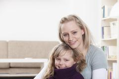 Stock Photo of Germany, Bavaria, Munich, Mother and daughter sitting at home