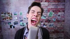 Man shouting goal into microphone., click for HD Stock Footage