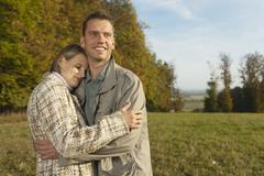 Stock Photo of Germany, Bavaria, Mid adult man holding woman, smiling
