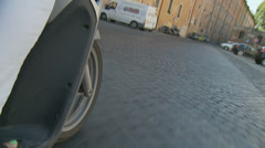 Scooter wheel on pebbled street, Rome - slomo Stock Footage