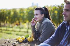 Croatia, Baranja, Young man and woman at apple harvest - stock photo
