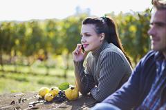 Croatia, Baranja, Young man and woman at apple harvest Stock Photos
