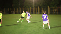 Youth playing football. Pass, shot on goal. Amateur team soccer., click for HD - stock footage