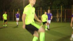 Football player tricks and strikes on goal. Soccer team match, click for HD Stock Footage