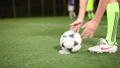 Stock Video Footage of Ball placed on a penalty spot, soccer player strikes on goal, click for HD