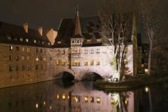 Germany, Bavaria, Franconia, Nuremberg, View of Heilig-Geist-Spital with Pegnitz - stock photo