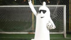 Condom man kicks a ball., click for HD Stock Footage