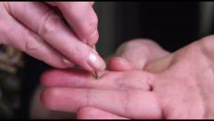 Acupuncture moxa is placed on a hand after using a touch pen., click for HD Stock Footage