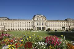 Germany, Bavaria, Wuerzburg, View of garden with wuerzburg residence in - stock photo