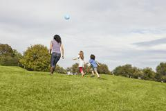 Germany, Bavaria, Family playing with balloon in park Stock Photos