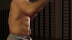 Muscular shirtless male torso punching, preparing to box match, click for HD Stock Footage