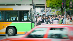 Traffic through frame on Japanese crossing Stock Footage