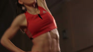 Stock Video Footage of Young female with athletic body fitness exercise for muscles, click for HD