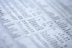 Extreme close up of stock exchange financial figures in newspaper - stock photo
