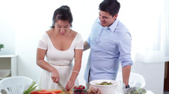 Young Couple Cutting Vegetables and Preparing a Healthy Meal Together Stock Footage