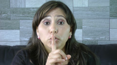 Closeup of woman making a hush gesture Stock Footage